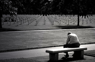 World War II veteran remembering D-Day in Normandy at the US cemetery, Colleville-sur-mer, France
